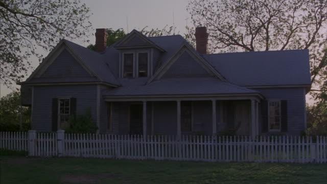 Medium shot of a rural Texas farmhouse.
