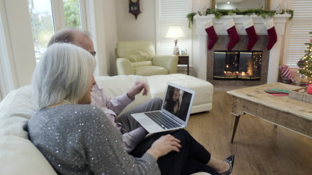 medium shot of a senior couple video chatting - jumper stock videos & royalty-free footage