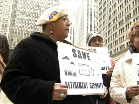 medium shot of a senior holding a sign to promote retirement security at 'occupy chicago.' senior citizens gathered in the city to join the protests... - anonymous activist network stock videos & royalty-free footage