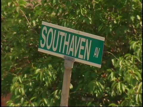 medium shot of a southaven avenue street sign near haven drugs pharmacy, the location of a shooting in long island that resulted in the death of four... - crime or recreational drug or prison or legal trial 個影片檔及 b 捲影像