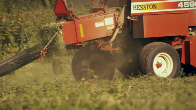 medium shot of a square hay baler - hay baler stock videos & royalty-free footage