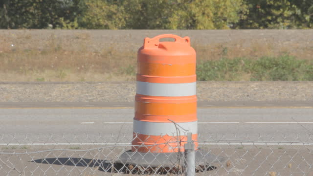 medium shot of a traffic cone. - traffic cone stock videos & royalty-free footage