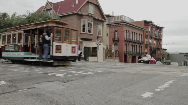 Medium Shot of a trolley car passing in San Francisco