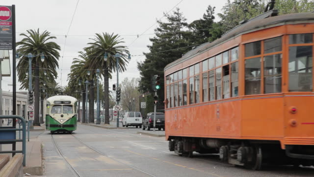 medium shot of a trolley pulling up to a stop in san francisco - trolley bus stock videos & royalty-free footage