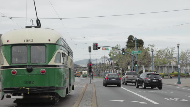 Medium Shot of a trolley pulling up to a stop light in San Francisco