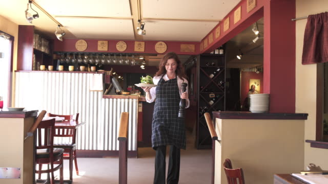 medium shot of a waitress with a plate of food - plate stock videos and b-roll footage