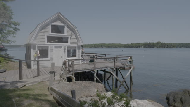 Medium shot of a waterfront house in Boothbay Harbor