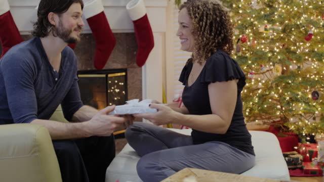 vídeos y material grabado en eventos de stock de medium shot of a woman giving a gift to her husband - generosidad