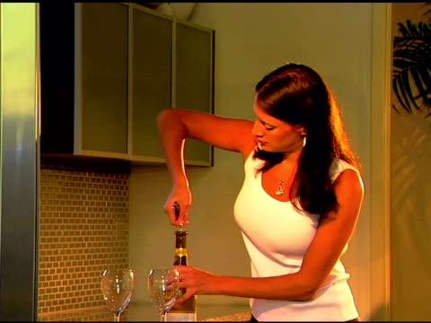 medium shot of a woman using a corkscrew to open a bottle of wine. - corkscrew stock videos & royalty-free footage