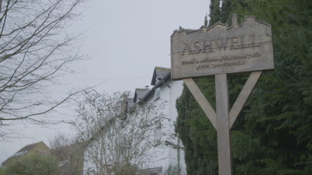 medium shot of a wooden village sign in ashwell - evergreen stock videos & royalty-free footage