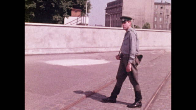medium shot of a young policeman patrolling the berlin wall in east berlin; 1970. - 20 29 years stock videos & royalty-free footage