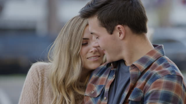 stockvideo's en b-roll-footage met medium shot of affectionate couple kissing in city / provo, utah, united states - provo