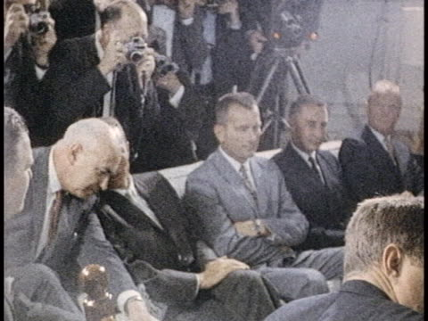medium shot of alan shepard sitting on a couch with two men sitting to his right and one man on a chair between him and the camera. cut to president... - sputnik stock videos & royalty-free footage