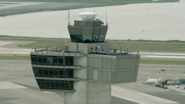 medium shot of an air traffic control tower at john f. kennedy international airport - tower stock videos & royalty-free footage