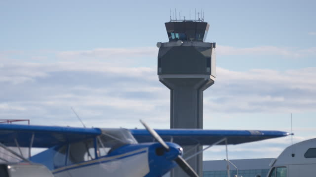 medium shot of an airplane - air traffic control tower stock videos and b-roll footage