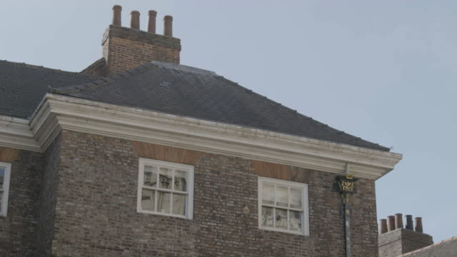 medium shot of an old building at minster yard - 18th century stock videos & royalty-free footage