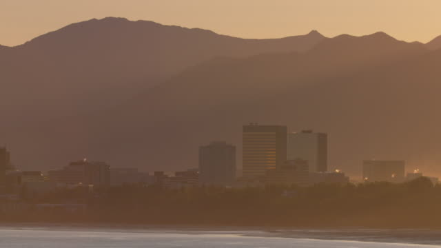 medium shot of anchorage cityscape at sunrise - anchorage alaska stock videos & royalty-free footage