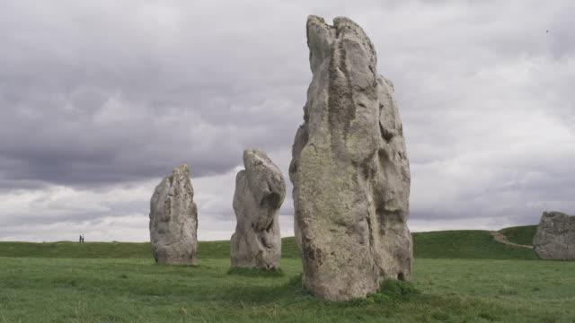medium shot of ancient stones in formation / avebury, england, united kingdom - avebury stock videos & royalty-free footage