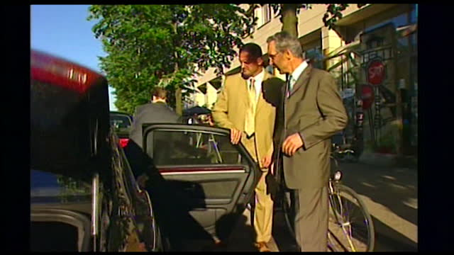 medium shot of angela merkel climbing into a black car and being driven off; 2005. - passenger seat stock videos & royalty-free footage