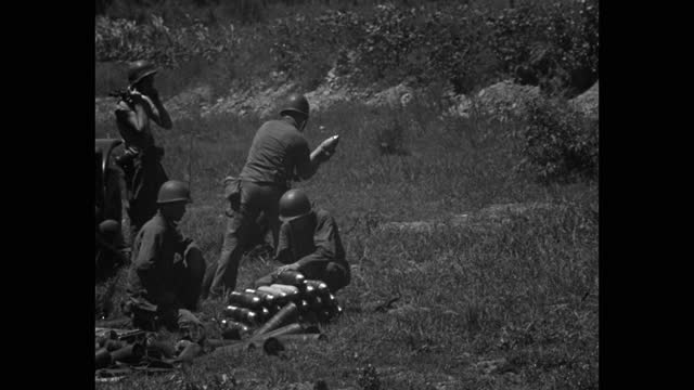 medium shot of army soldiers loading mortar with shells - four people stock videos & royalty-free footage