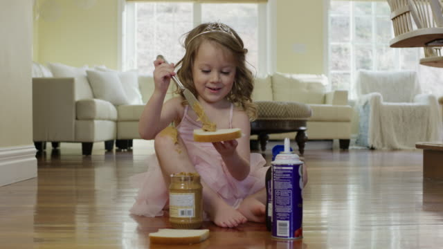 """medium shot of ballerina girl spreading peanut butter on bread / cedar hills, utah, united states"" - peanut food stock videos & royalty-free footage"