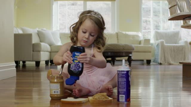 """medium shot of ballerina girl squeezing jelly onto bread / cedar hills, utah, united states"" - children only stock videos & royalty-free footage"