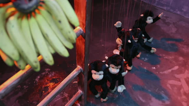 medium shot of bananas hanging on ladder and monkey puppets dancing on stage during puppet show - puppet stock videos & royalty-free footage