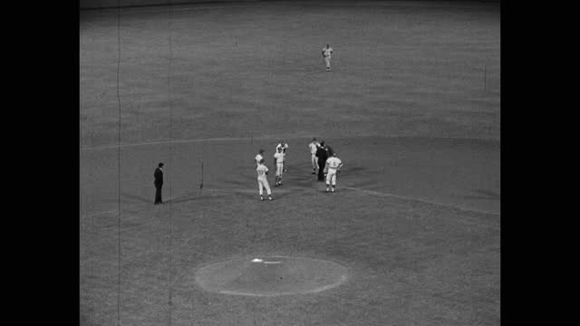 medium shot of baseball player arguing with umpire on baseball diamond, dodger stadium, los angeles, california, usa - medium group of people stock videos & royalty-free footage