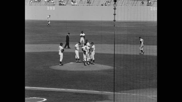 medium shot of baseball players talking before game on baseball diamond, dodger stadium, los angeles, california, usa - medium group of people stock videos & royalty-free footage