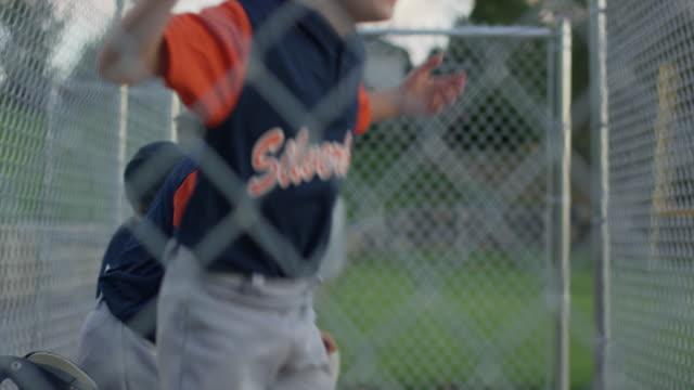 medium shot of baseball team cheering / american fork, utah, united states - baseball sport stock videos & royalty-free footage