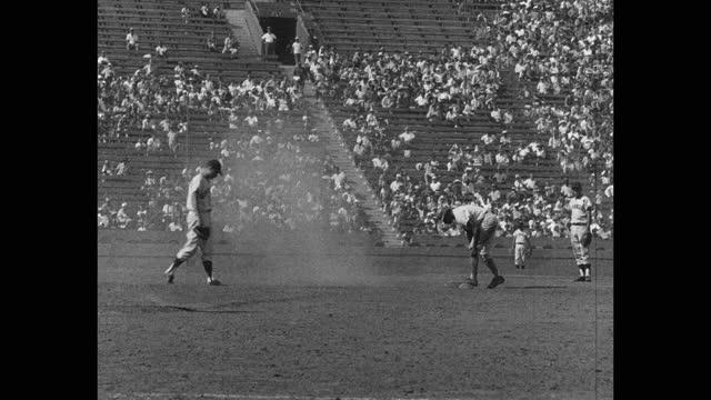 medium shot of baseball umpires gesturing at baseball players playing game on baseball diamond - baseball strip stock videos & royalty-free footage
