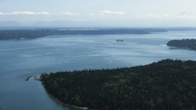 Medium shot of Blake Island with Mount Rainier in the background