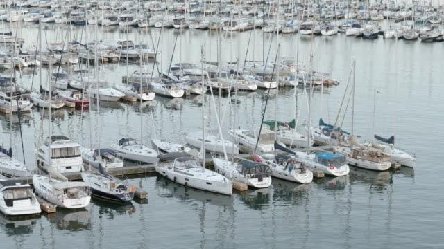 medium shot of boats moored at harbor at humber bay park west, toronto, ontario, canada. - pier stock videos & royalty-free footage