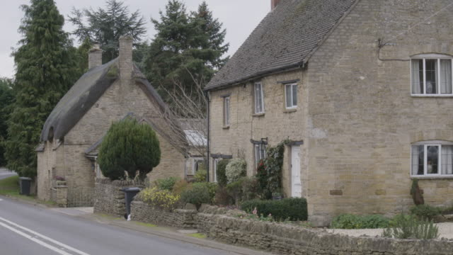 medium shot of british homes at shipston road in long compton - bin stock videos & royalty-free footage