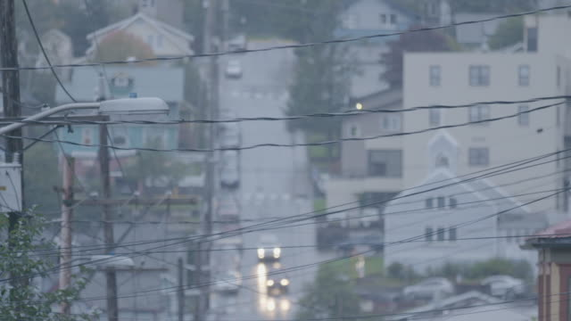 medium shot of cables in front of a streetscape of juneau - juneau stock videos and b-roll footage