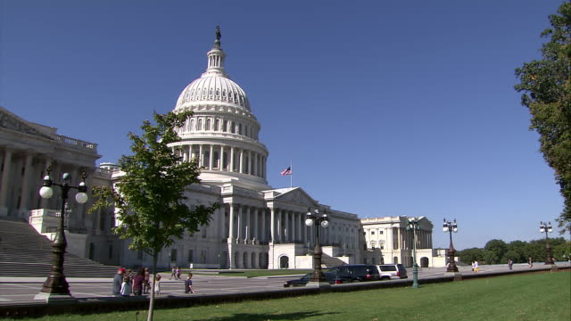 a medium shot of capitol building where the american flag is at half staff due to the death of former speaker of the house tom foley - united states and (politics or government) stock videos & royalty-free footage