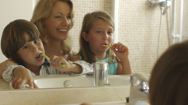 medium shot of children brushing their teeth/marbella region, spain - bathroom sink stock videos & royalty-free footage