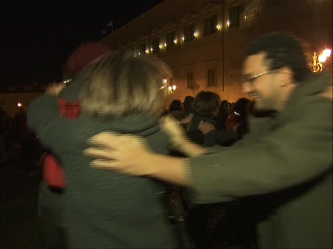 medium shot of citizens celebrating the resignation of prime minister silvio berlusconi with a conga line he stepped down after failing to pass... - business or economy or employment and labor or financial market or finance or agriculture video stock e b–roll