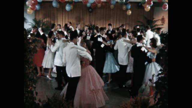 medium shot of couples dancing during party - formell klädsel bildbanksvideor och videomaterial från bakom kulisserna