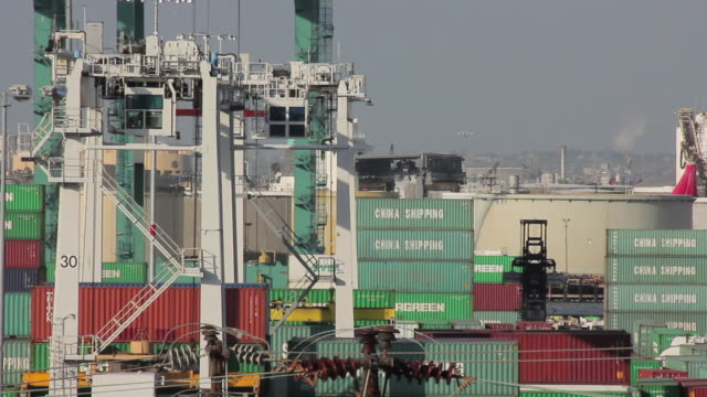 medium shot of cranes at the port of los angeles - port of los angeles stock videos & royalty-free footage