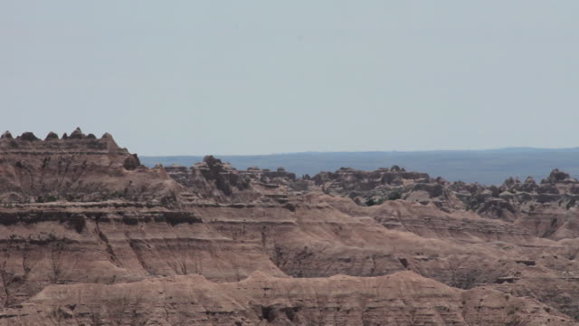 medium shot of crested buttes in badlands national park - badlands national park stock videos & royalty-free footage