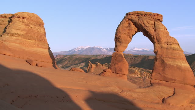Medium shot of Delicate Arch at sunset -- no people visible - pan