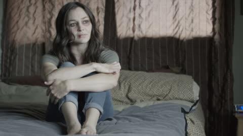 medium shot of domestic abuse victim crying on bed / springville, utah, united states - springville utah stock videos & royalty-free footage