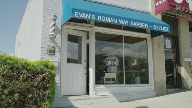 Medium shot of door ajar at barber shop / Pleasant Grove, Utah, United States
