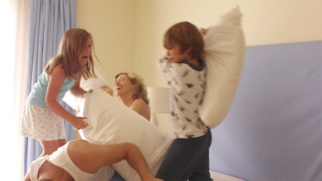 medium shot of family having a pillow fight/marbella region, spain - play fight stock videos and b-roll footage
