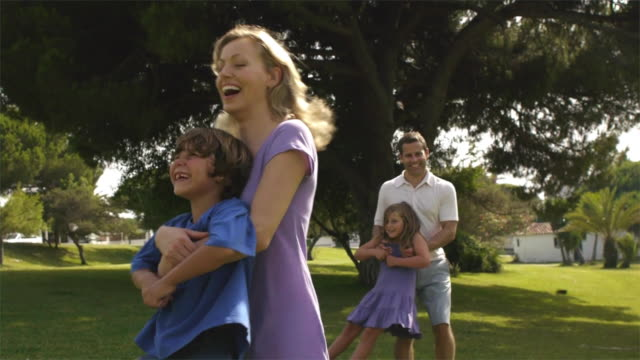 medium shot of family playing in park/marbella region, spain - sister stock videos and b-roll footage
