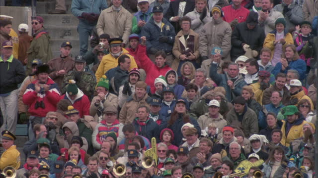 medium shot of fans at the notre dame vs. boston college football game. - marching band stock videos and b-roll footage