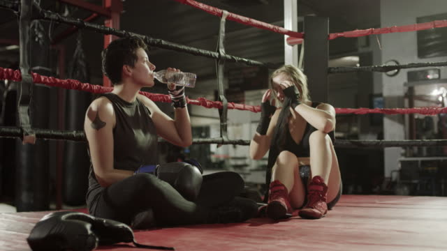 Medium shot of female boxers resting after workout / Lehi, Utah, United States