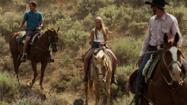 medium shot of friends horseback riding / idaho, united states - 乗馬点の映像素材/bロール