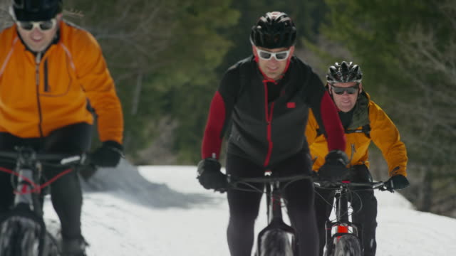 medium shot of friends riding fat bikes on mountain / american fork canyon, utah, united states - american fork canyon stock videos and b-roll footage